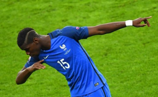 France's midfielder Paul Pogba celebrates after scoring his team's second goal  during the Euro 2016 quarter-final football match between France and Iceland at the Stade de France in Saint-Denis, near Paris, on July 3, 2016.  / AFP PHOTO / Francisco LEONGFRANCISCO LEONG/AFP/Getty Images